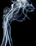 Smoke. Swirls of smoke on a black background Royalty Free Stock Photo