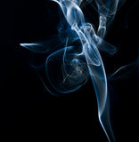 Smoke. White smoke over black background Royalty Free Stock Photo