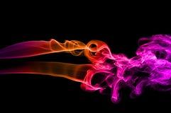 Smoke. Color smoke on black background Stock Photos