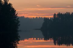 In smoke. Decline on lake in a smoke from forest fire Stock Images