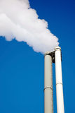 Smoke. From a chimney on a blue sky Stock Photos
