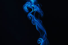 Smoke. Abstract blue smoke black background Royalty Free Stock Photography
