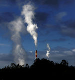 Smoke. Industrial chimneys exhausting dangerous smokes into the atmosphere stock images