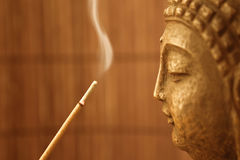 Smoke 4 buddha. Buddha sculpture and smoke for meditation stock photos