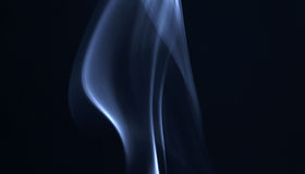 Smoke. Blue smoke abstract in white background with reflection Royalty Free Stock Photography