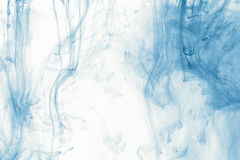 Smoke abstract background cloud of paint on white. Color ink drop in water Stock Image
