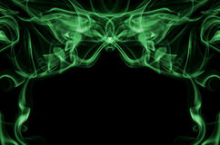 Smoke abstract. Green smoke abstract background isolated on black Stock Photos