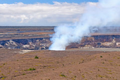 Smoke from an active volcanic crater Stock Images