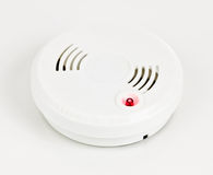Smoke alarm. A smoke alarm with a bright red button Stock Images
