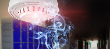 Composite image of smoke alarm stock images