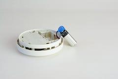 A smoke alarm. Changing the battery on a smoke alarm Stock Image