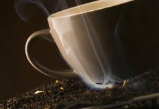 Smoke around cup of tea Royalty Free Stock Photos