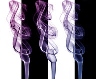 Smoke art. Colorful smokes on background with black and white stripes Royalty Free Stock Photos