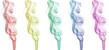 Smoke art. Smokes with different colors on white background Royalty Free Stock Photo