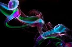 Smoke art. Unusual pattern of Rainbow Twirling Smoke Stock Image