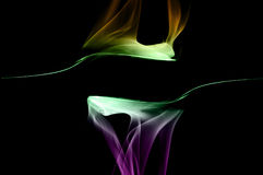 Smoke art. With black background in toned color royalty free stock photo