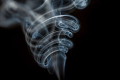 Smoke background. Cigarette smoke in black background Royalty Free Stock Photography