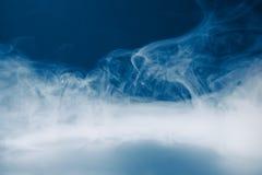 Smoke background and dense fog Stock Image