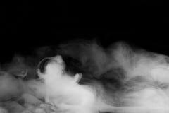 Smoke background. Movement of smoke on black background Stock Image