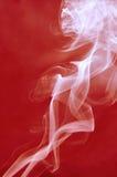Smoke background. White smoke on red background Stock Photo