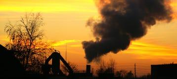 Smoke belcher. Photo of manufacturing belching dark smoke into the air Royalty Free Stock Image