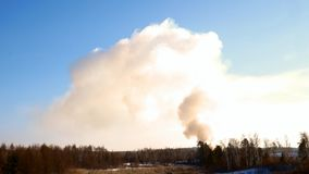Smoke billowing from a controlled fire at a landfill site in winter in Minnesota. Smoke billowing from a controlled fire at a landfill site in winter in stock footage