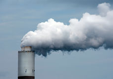 Smoke Billowing out of a Smoke Stack Stock Photo