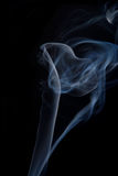 Smoke on black background. Smoke from a cigarette isolated on black background royalty free stock photo