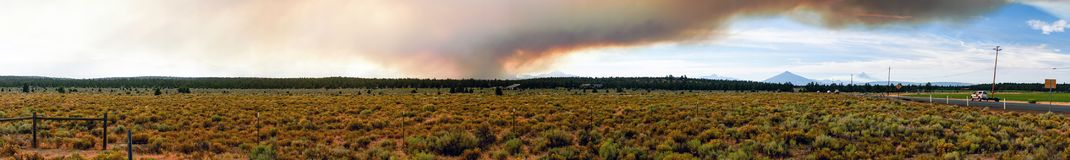Long Panoramic Cascade Mountain Range Forest Wildfire. Smoke blocks out the sun and The Cascade Mountain Range Mt Jefferson Ranch land stock photography