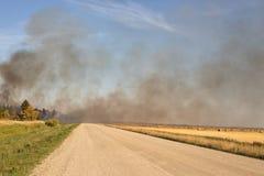 Smoke blowing across road Stock Image