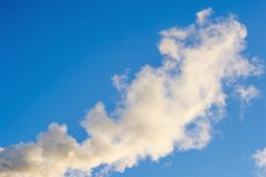 Smoke on blue sky background. Abstraction, a symbol. Smoke on blue sky background. Abstraction, a symbol Stock Photo