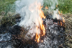 Smoke from burning dry grass Royalty Free Stock Images