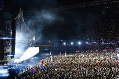 Smoke cannons emitting smoke on crowd at a concert Stock Images