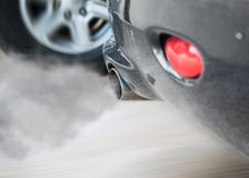 Smoke car pipe exhaust,Smoke from a car producing pollution. Smoke car pipe exhaust, Smoke from a car producing pollution Stock Images