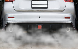 Smoke from a car producing pollution,smoke car pipe exhaust.  stock images