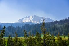Landscape in Lassen Volcanic National Park. Smoke carried by the wind from the nearby wildfires covering Lassen Volcanic National Park; Lassen Peak visible in Royalty Free Stock Photo