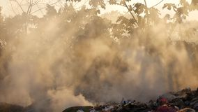 Smoke caused by burning of solid waste. Smoke caused by burning, solid waste and causing air pollution stock footage