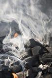 Smoke and charcoal Stock Image