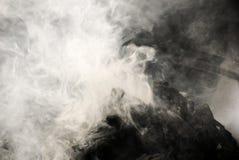 Smoke and charcoal Stock Images