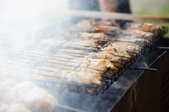 Smoke chicken in grates Stock Images