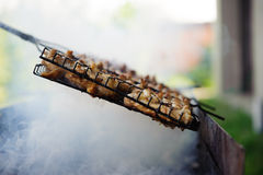 Smoke chicken in grates Stock Photos
