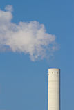 Smoke and a chimney. The picture shows smoke and a chimney stock image