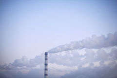 The smoke from the chimney. Smoke from the chimney on the sky Royalty Free Stock Photography