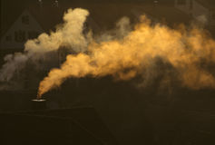 Smoke from a chimney Stock Image