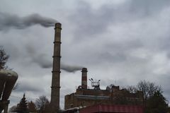 Smoke from the chimney of an air polluting plant stock photo