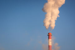 Smoke from the chimney and blue sky.  royalty free stock images