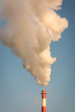 Smoke from the chimney and blue sky.  stock photography