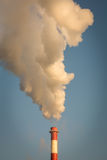 Smoke from the chimney and blue sky.  stock photos