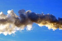 Smoke from chimney on clear blue sky. Stock Photos