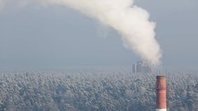 The smoke from the chimney on a cold winter day stock footage